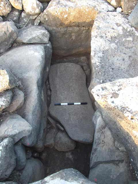 25. Dolmen 51: burial chamber floor, looking west.