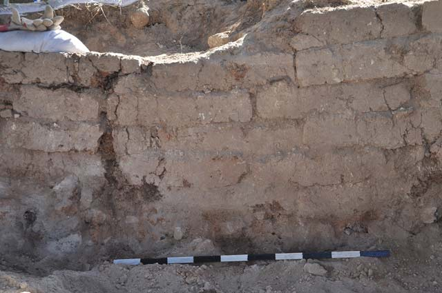18. Area B2, a mud-brick wall whose bricks were burnt in the destruction, looking south.