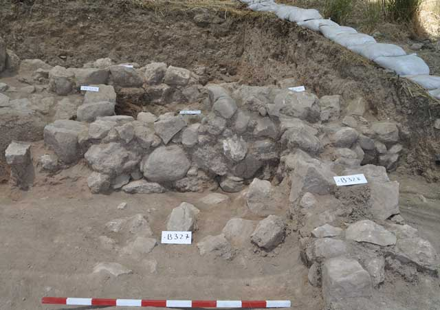 23. Area B2, remains of a residential building from the eleventh century BCE, looking west.