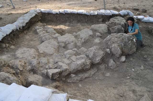 7. Area A, remains of a building from the eleventh century BCE, looking east.